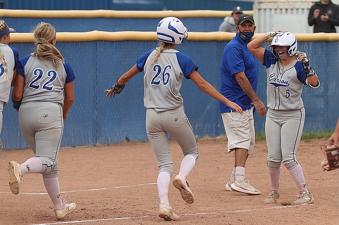 Carson High's Caydee Farnworth celebrates on third base after hitting a walk-off to right field Saturday afternoon to beat Douglas in the regular-season finale.
