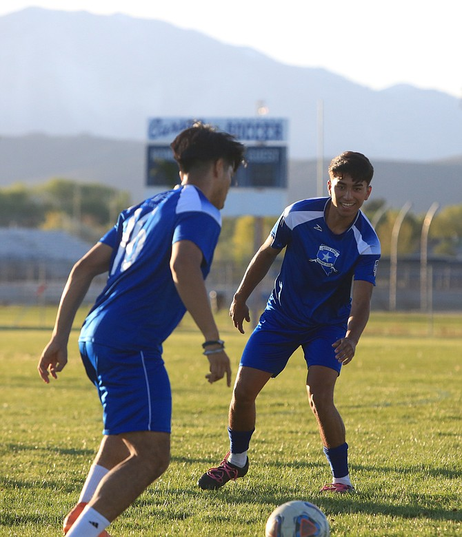 Isael Lopez smiles as he works through a drill with his Battle Born FC teammates Tuesday evening on Carson High's practice field. Lopez and the rest of the roster are eager to take advantage of an opportunity to showcase their skills at the semi-professional level.