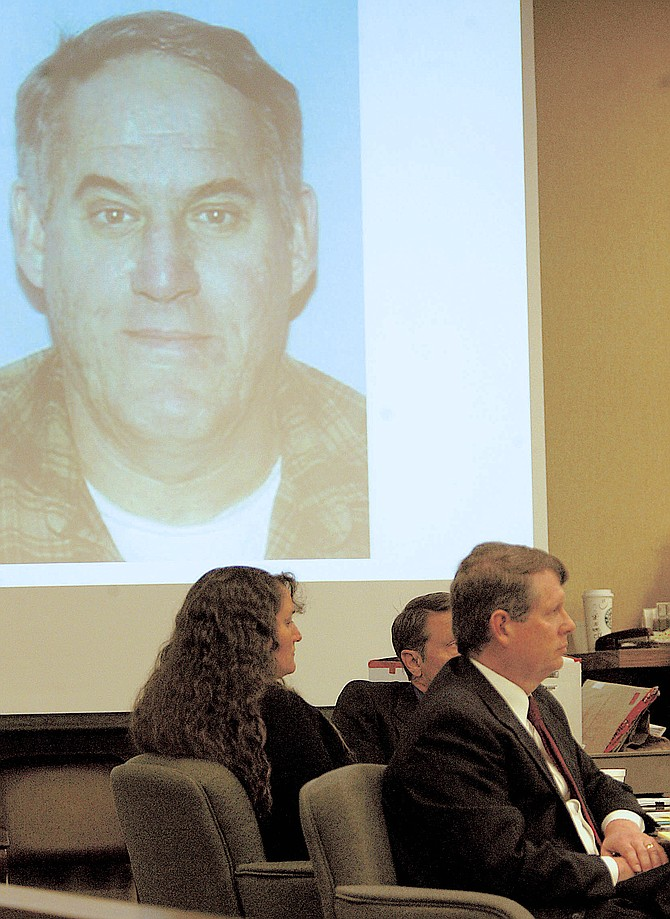 Karen Bodden sits with her attorneys as a photo of her murdered husband Robin appears on the screen above them in this 2008 file photo by R-C Photographer Shannon Litz.