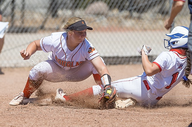 Douglas High's Emma Glover makes a tag out at third base during a contest against Reno earlier this season. Glover and the Tigers bested Reno to open regional play Tuesday.
