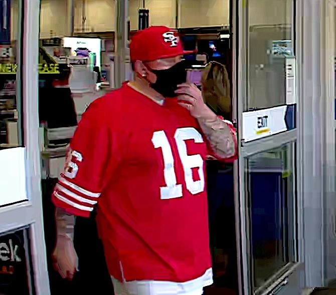 A man wearing a 49ers hat and shirt is being sought in connection with a theft from the Best Buy.