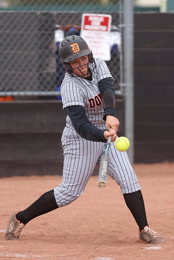 Ashley Delaney ropes her third-inning home run against Reno High in the Northern Nevada Class 5A regional softball tournament. Delaney drove in three RBIs in the win.