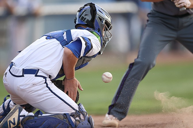 Carson High catcher Bryce Baker blocks a ball behind the plate during a game against Spanish Springs in early May. Baker was named the Class 5A Defensive Player of the Year for his efforts behind the plate, where he had become a mainstay for Carson.
