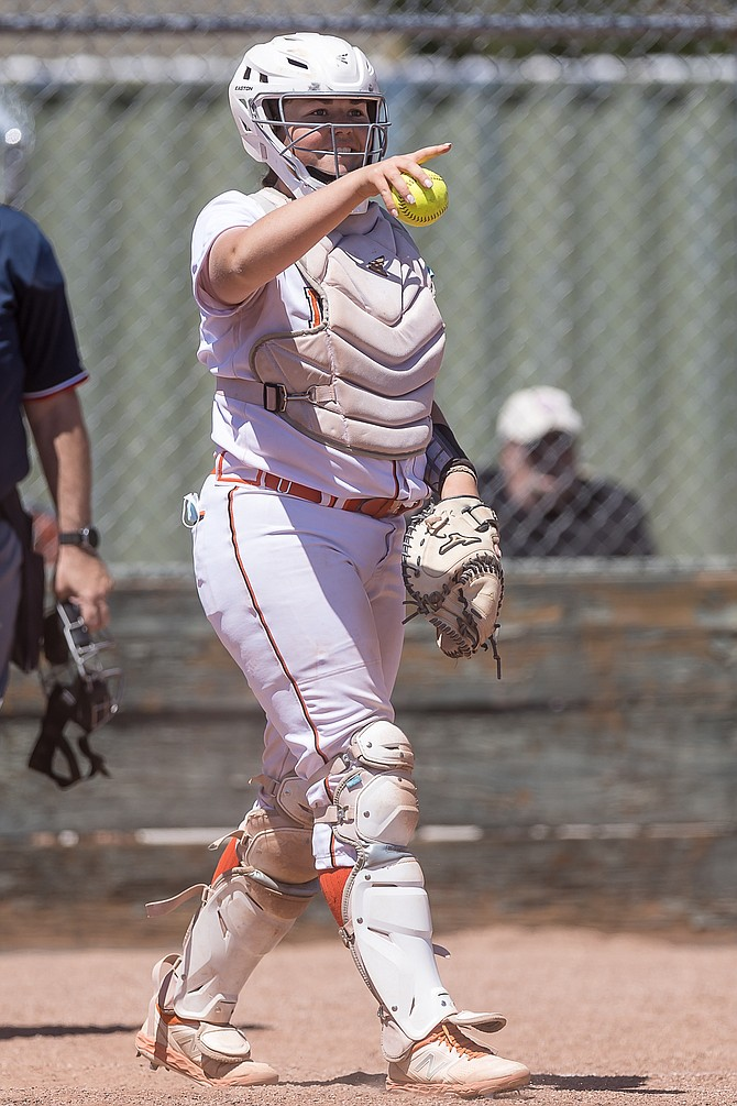 Douglas high catcher Ryleigh Blaire directs the action during a Tiger softball game this season. Blaire was a first team all-region selection as Douglas' top power hitter in 2021.