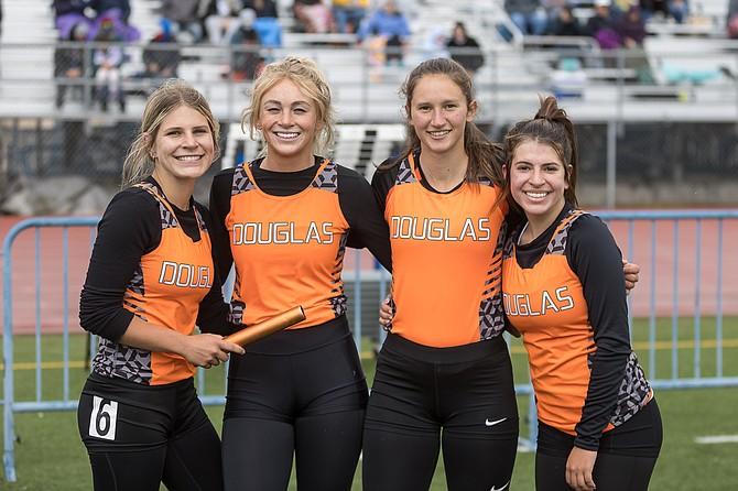 Douglas High's 4x200 relay team smiles after winning a regional title. Pictured from left to right are Jessica James, Ellie Gansberg, Megan Veil and Julianne James.