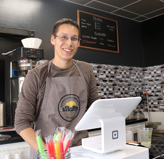 Kyle Stenberg, co-owner of Biggest Little Boba Shop, mans the counter inside the downtown Reno business on Wednesday, May 27.