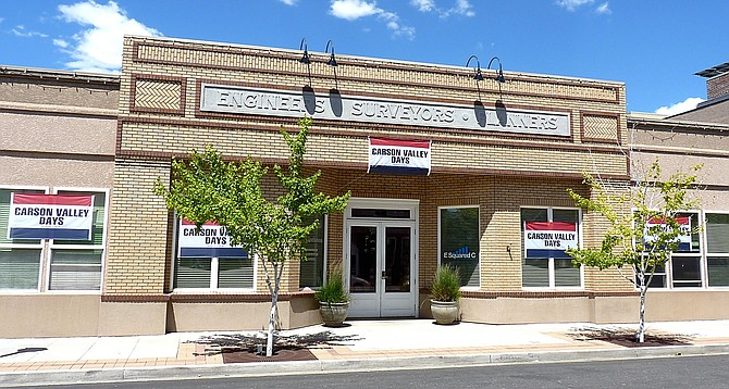 RO Anderson Engineering in downtown Minden covered with Carson Valley Days Banners before the 2015 parade.