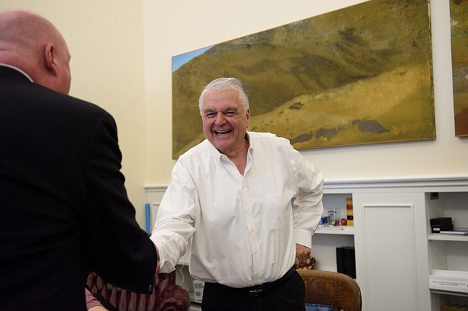 Gov. Steve Sisolak shakes hands with journalist Steve Sebelius after a roundtable discussion with reporters about the 2021 session in Carson City on June 1, 2021.