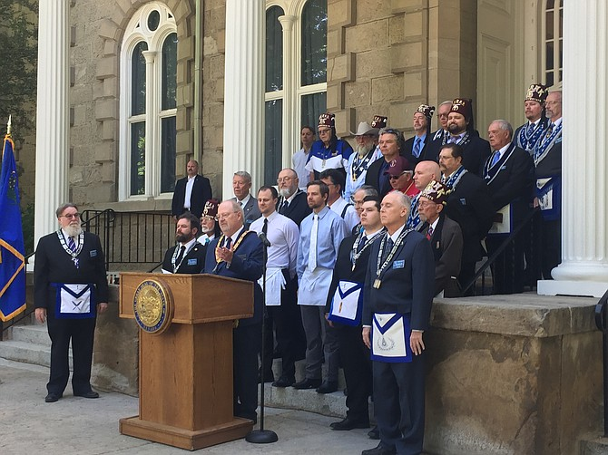 Led by Grand Master of Masons in Nevada Mark A. Marsh, members Northern Nevada's Freemason lodges gather on the capitol steps to help rededicate the building for its 150th anniversary.