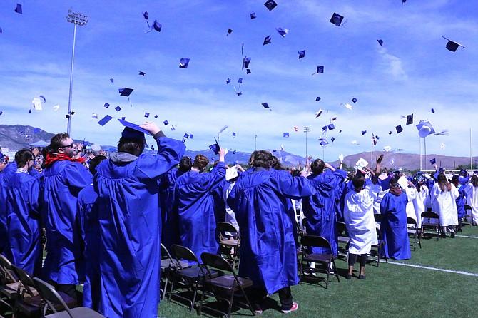 Carson High School's graduates toss their caps in celebration Saturday.