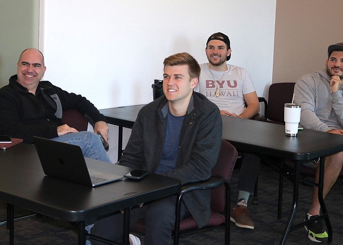 Members of the three companies accepted into the 2021 spring cohort of RNOX's accelerator program —including Alliance Forge and PersonaFi — gather for a workshop inside the RNOX offices in South Reno in March.