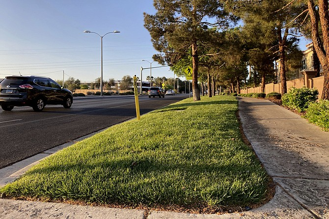 Traffic passes a grassy landscape on Green Valley Parkway in suburban Henderson on April 9. (Ken Ritter/AP, file)