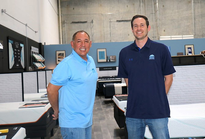 Sierra Mattress Company co-owners Tony Gurule, left, and Matt Freeman stand inside the company's store on Longley Lane in Reno on Tuesday, May 25.