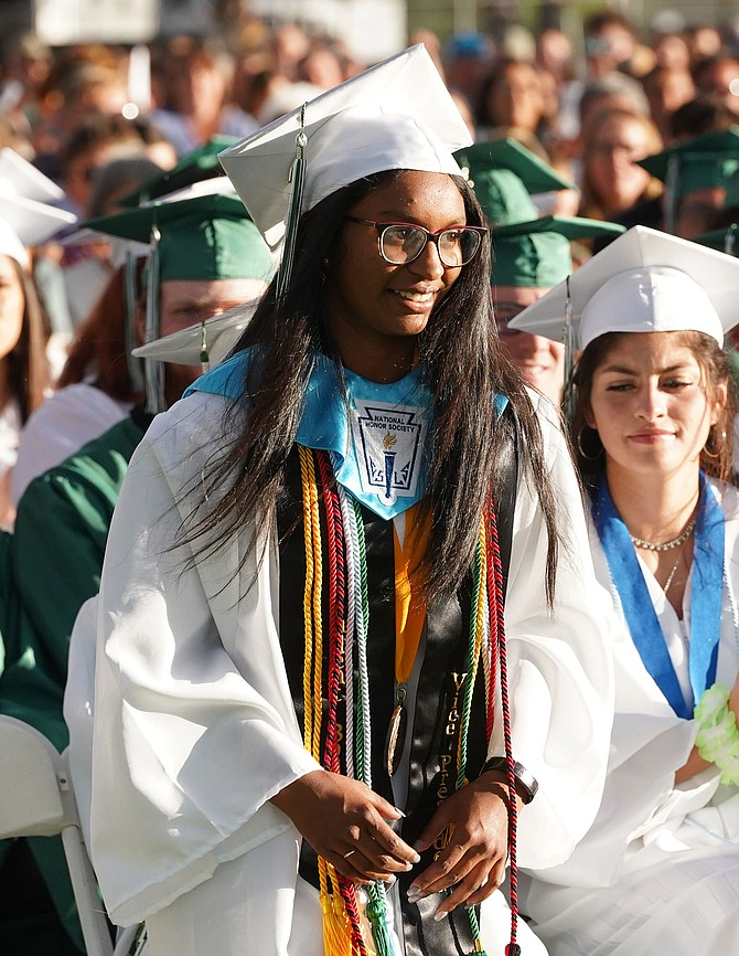 Honors School Co-valedictorian Vera Vaz walks up to the stage before giving her speech.