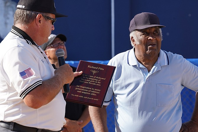 Fallon's Brian Itskin, left, presented Richard Pitts with a Lifetime Achievement Award during the 2019 youth softball state tournament in Reno.