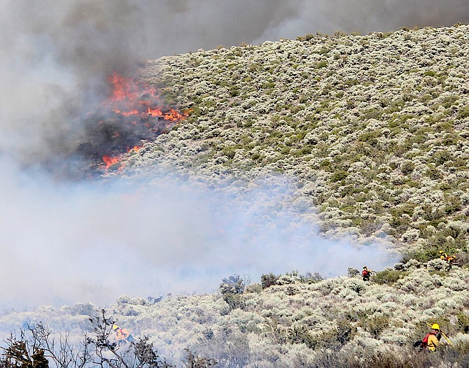 Fire burns up the hill between Alpine View and Jacks Valley on Wednesday. The 700-acre fire was 75 percent contained by 10 p.m..