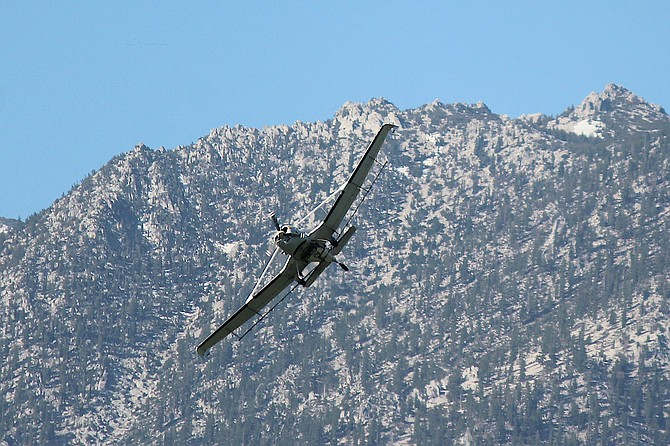 A crop-duster conducts aerial spraying of larvicide over the damper portions of Carson Valley on Tuesday morning for the Douglas County Mosquito Abatement District.