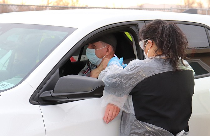 A man receives his COVID vaccination at the Churchill County Public Health drive-through site.