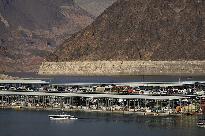 A bathtub ring of light minerals delineates the high water mark on Lake Mead at the Lake Mead National Recreation Area near Boulder City on Aug. 13, 2020. (Photo: John Locher/AP, file)