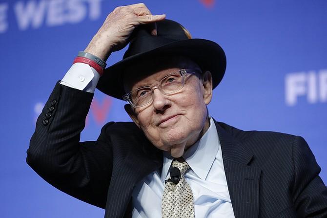 Former Senate Majority Leader Harry Reid tips his hat during a fundraiser for the Nevada Democratic Party in Las Vegas on Nov. 17, 2019. (John Locher/AP, file)