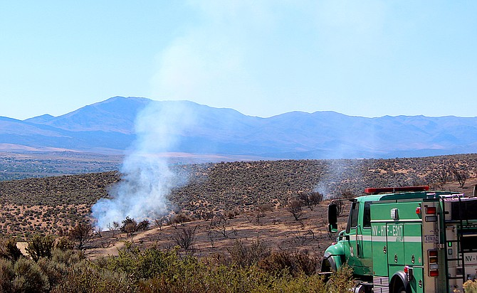 A U.S. Forest Service truck heads toward one of the last big hot spots in the Jacks Valley Fire on Thursday morning.
