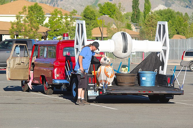 An imperial TIE fighter is on the tail of the antique Minden ambulance as entries in the annual Carson Valley Days Parade gather at Douglas High School on Saturday morning. The theme of the 2021 parade is In a Galaxy Far Far Away.