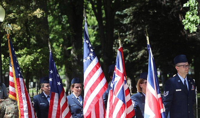 The Nevada Air National Guard NCO Academy Graduates Association holds flags from different eras of the United States.