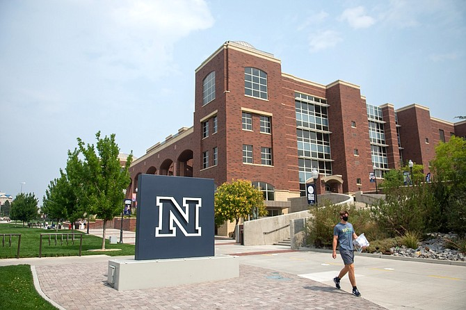 A student walks on the University of Nevada, Reno campus on Tuesday, Aug. 25, 2020.