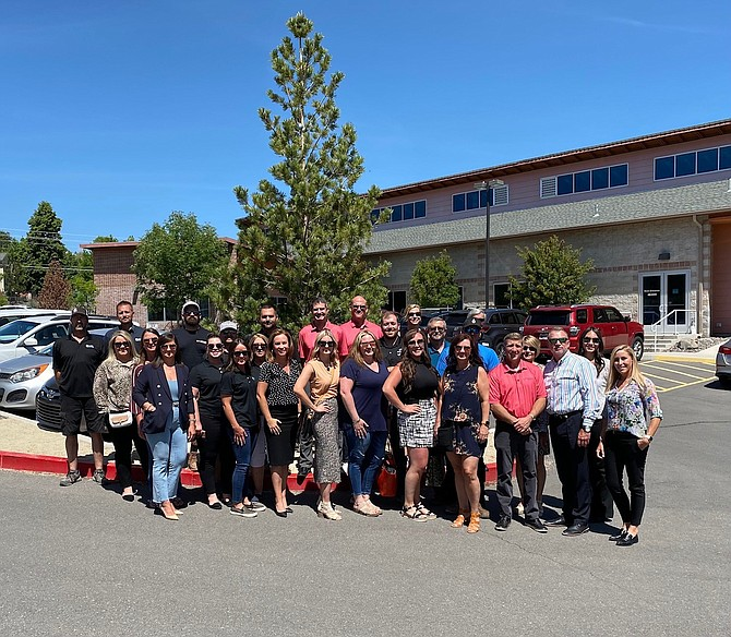 """Volunteers with the Builders Association Charity, as well as Ryder Homes, Toll Brothers, Tanamera and Di Loreto Homes of Nevada, gathering with nonprofit STEP2 officials to kick off the """"5th Annual Cottage Makeover."""""""