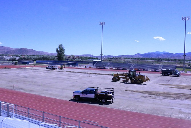 Work began Monday on Carson High School's stadium turf resurfacing and track improvement project, with the turf removed before noon. The project is expected to be complete by August. (Photo: Jessica Garcia/Nevada Appeal)