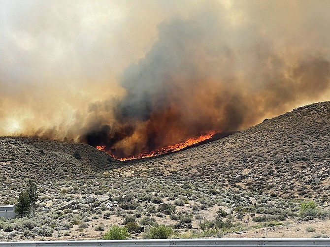 Flames from the fire burning north of Washoe Valley on Wednesday afternoon. The 300-acre Petrilla fire was the second medium sized blaze in the space of a week. Truckee Meadows Fire Protection District Photo