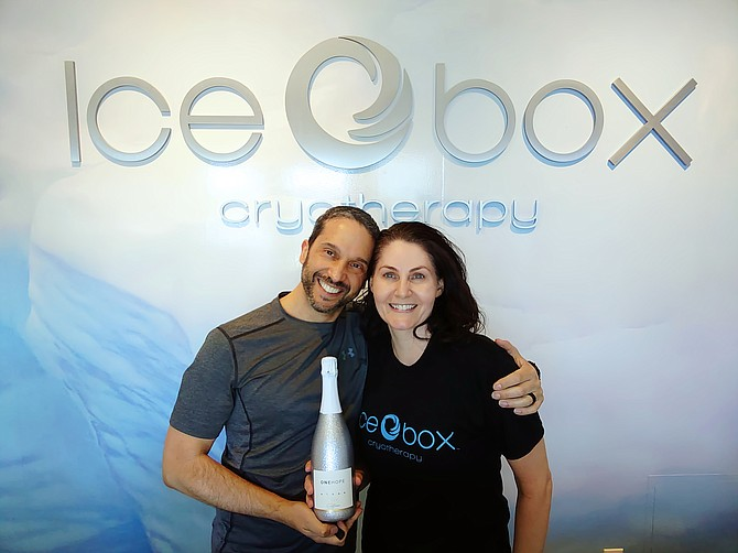 Chris Guzman, left, and his wife, Andrea, stand inside the Icebox Cryotherapy Studio that the couple opened in South Reno in June.