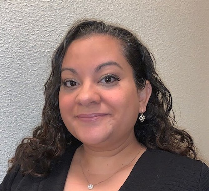 Candie Lorenzo works in the Office of the Civil Service Commission for the City of Reno.