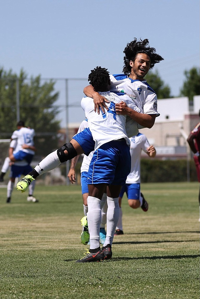 Battle Born FC's Guillermo Hernandez leaps into the arms of Junior Mailly (14) after scoring the first goal of BBFC's first postseason game.