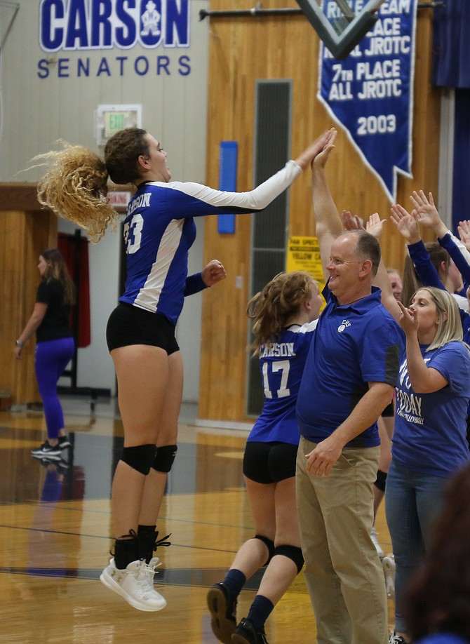 Robert Maw high fives Cami Larkin during a game in the fall of 2019. Maw stepped down as the Senators' volleyball coach this week after being in charge of the program since 2007.