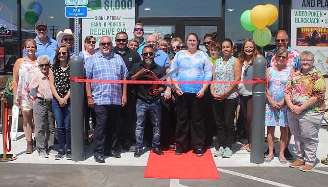 A ribbon cutting was conducted July 9 for Golden Gate Petroleum's Fallon facility. With the scissors is Nacho Aguilar, director of retail, Nevada/California, and to his right is District Manager Myron Johnson.