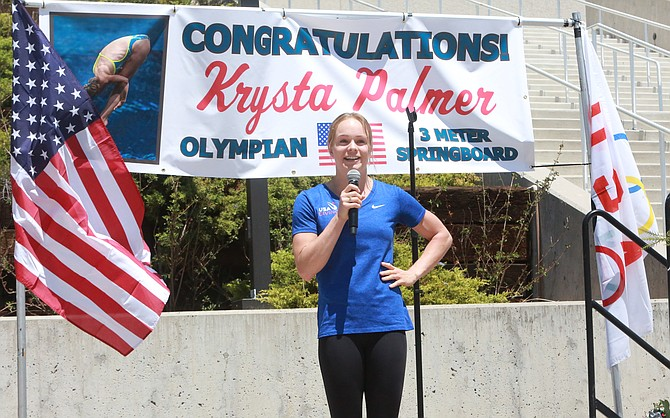 Douglas High graduate and Carson City native Krysta Palmer speaks to a crowd of about 50-75 people Monday in front of the Lawlor Events Center during her Olympic send off celebration.
