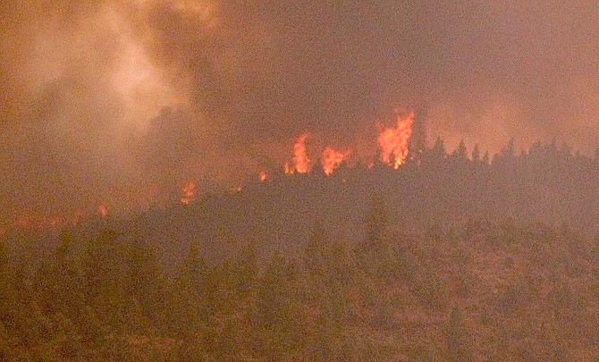 Flames can be seen from Highway 88 near Paynesville as they crest the ridge between Woodfords and Indian Creek Reservoir.