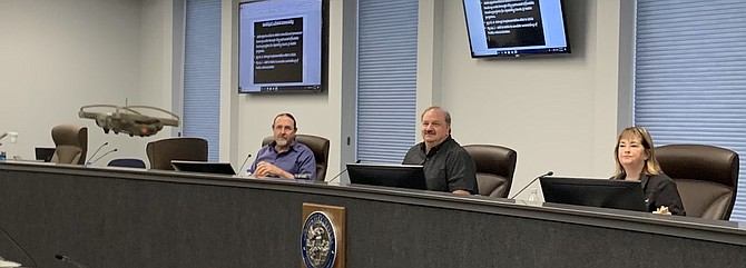 Mayor Lori Bagwell and Supervisors Stacey Giomi and Maurice White watch a drone presentation from the sheriff's office.