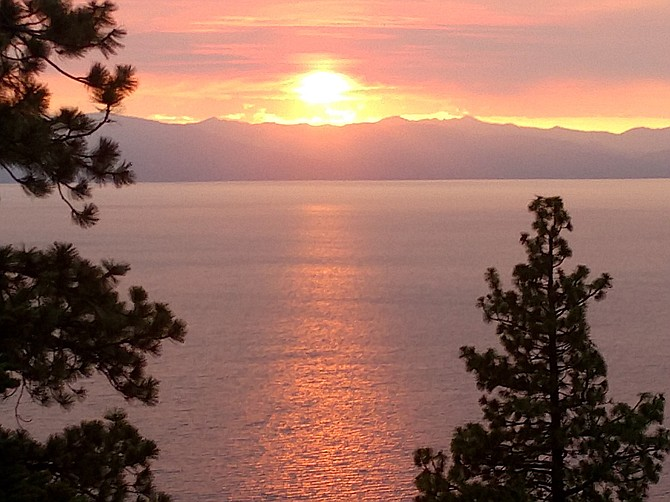 Smoke from the Tamarack Fire turns the sunset to orange over Lake Tahoe on Sunday evening in this photo taken by resident June Shafer.