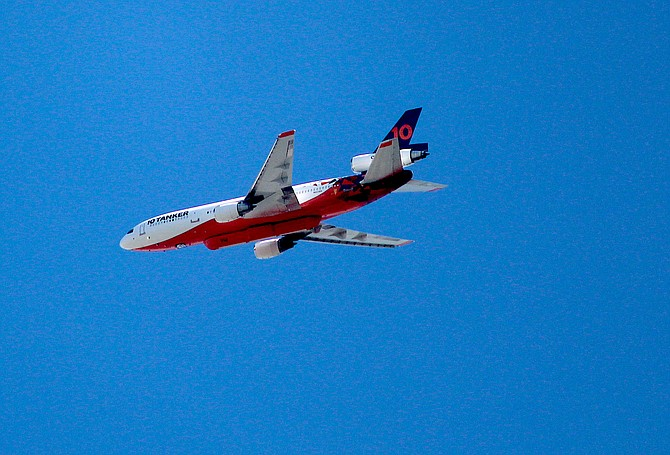 A DC-10 fire tanker circled over Carson Valley on Tuesday as clear skies permitted aerial firefighting to help slow down the Tamarack Fire.