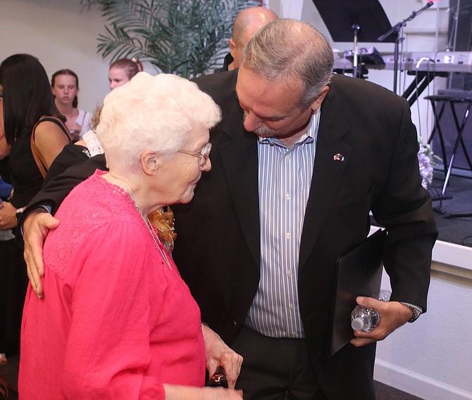 Steve Ranson / LVN Fallon Mayor Ken Tedford hugs Faye Tewell, widow of former Fallon City Councilman John Tewell, after his Celebration of Life.