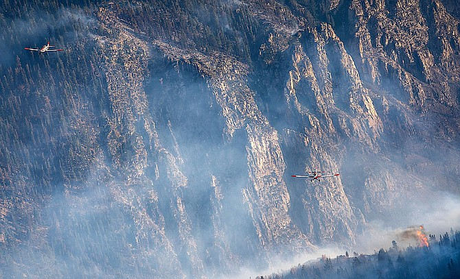 Single engine air tankers fly in formation over the rugged mountains where the Tamarack Fire has been burning out of control for a sixth day. U.S. Forest Service Photo