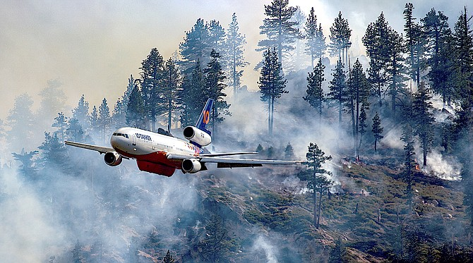 A DC-10 Tanker makes a pass over the Tamarack Fire on Tuesday.
