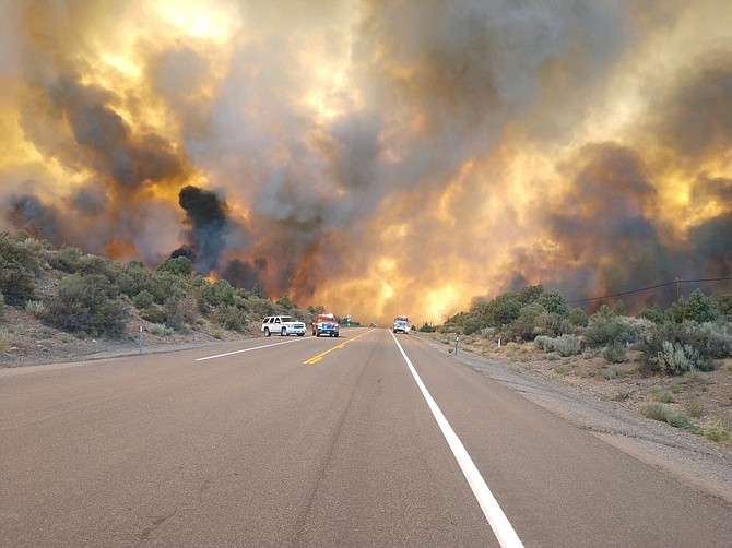 The Tamarack Fire burns across Highway 395 in this U.S. Forest Service photo.