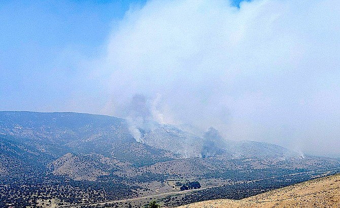 Smoke pours from the Tamarack Fire on Thursday morning in this photo taken by Topaz Ranch Estates resident John Flaherty from Gold Hill.