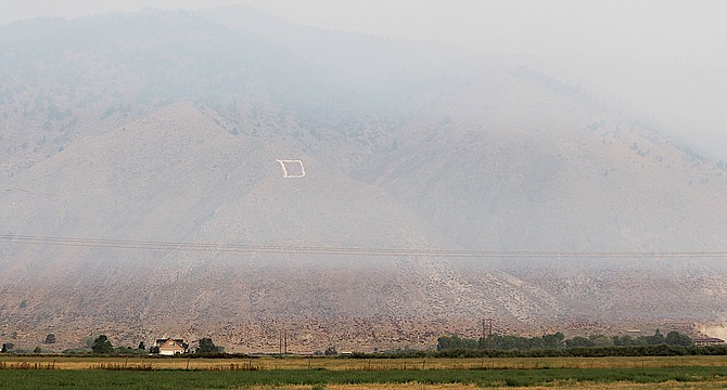 Carson Valley's famous inversion layer kept smoke off the deck for a short while on Sunday.