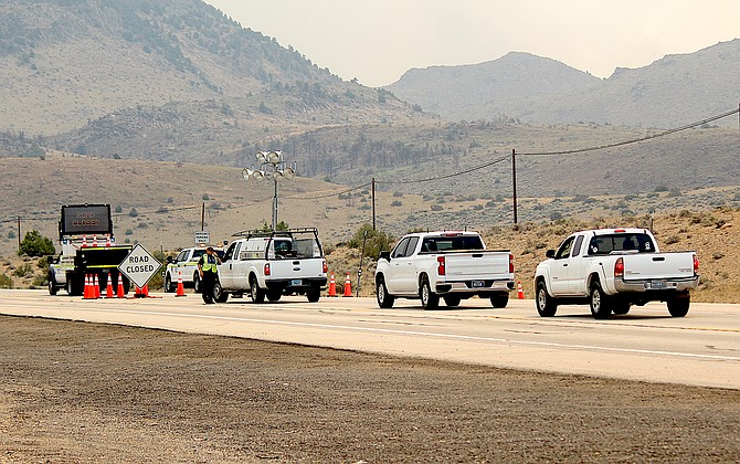 Vehicles line up at the Highway 395 closure in Bodie Flat for an escort through the fire area at about 1:40 p.m. on Thursday, about 10 minutes before the escorts were halted.