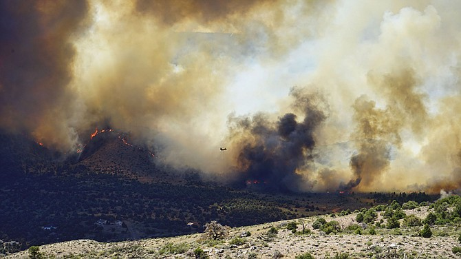 John Flaherty captured flames coming over the ridge in Douglas County.