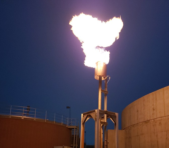 A flare from the Minden-Gardnerville Sanitation District burns off excess methane that's part of the normal process at the plant located next to the Ironwood Center. MGSD Photo